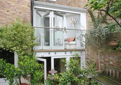Double Storey Conservatory with Folding Sliding Doors in Holland Park, London