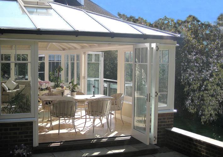 Conservatories orangeries roof lanterns hardwood for Conservatory sliding doors