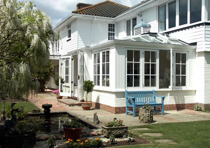 Conservatory on traditional weatherboard house in Sussex