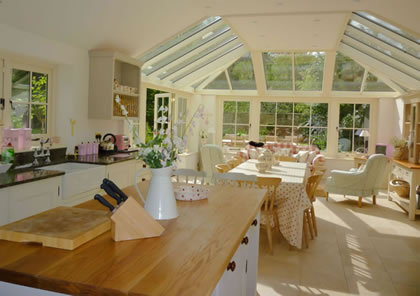 Roof Light and conservatory for kitchen and sitting area on Cotswold house