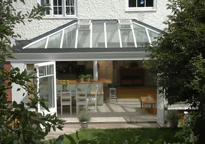Wide opening doors lead from conservatory kitchen extension in near Richmond South West London