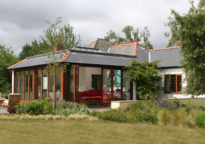 Orangery with Roof Lanterns and Folding Sliding Doors in Surrey